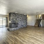 103 Akard Ave Montrose Colorado House for Sale Rock Fireplace in Living Room - Atha Team