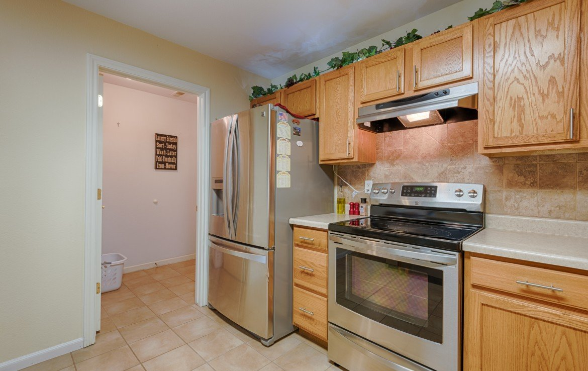 Open Kitchen with Adjacent Laundry Room - 1023 Deer Trail Montrose Real Estate - Atha Team