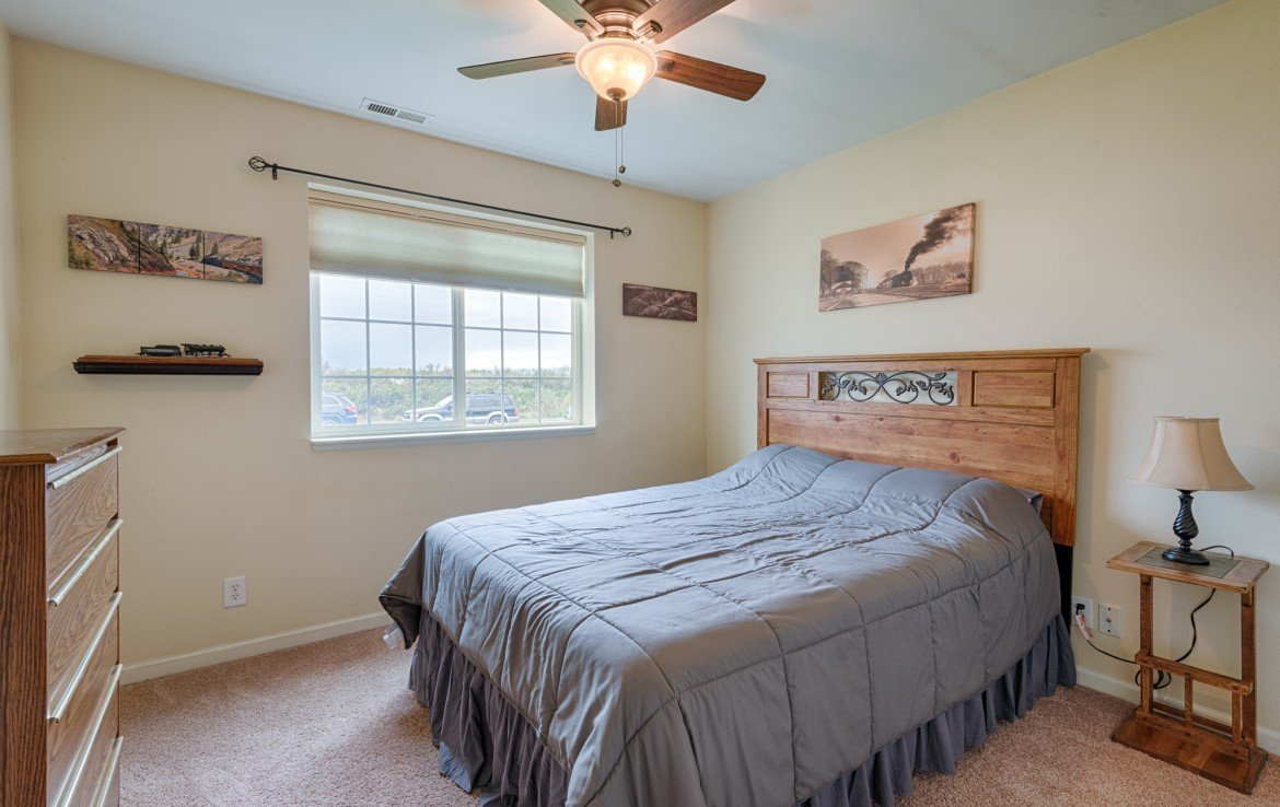 Bedroom with Ceiling Fan and Solar Shades - 1023 Deer Trail Montrose Real Estate - Atha Team