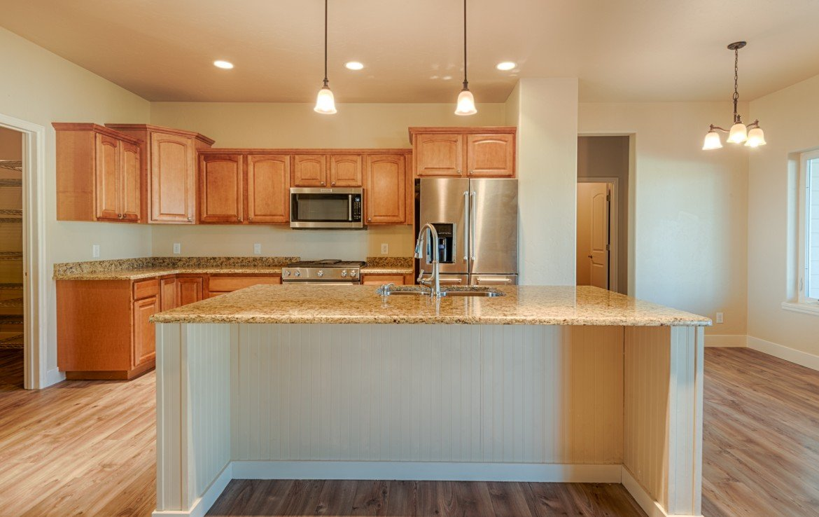 Remodeled Kitchen with Island Seating - 1828 Senate St Montrose, CO 81401 - Atha Team Real Estate