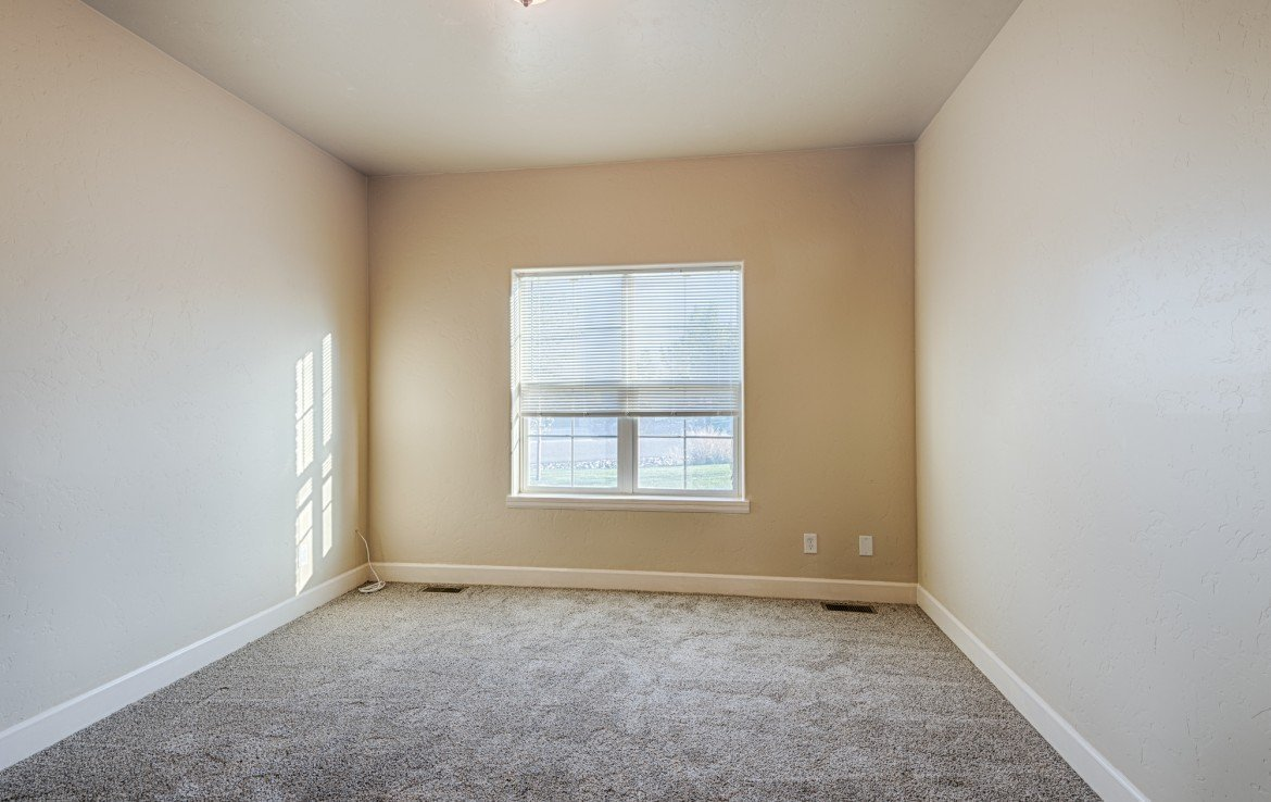 Bedroom with New Carpeting - 1828 Senate St Montrose, CO 81401 - Atha Team Real Estate