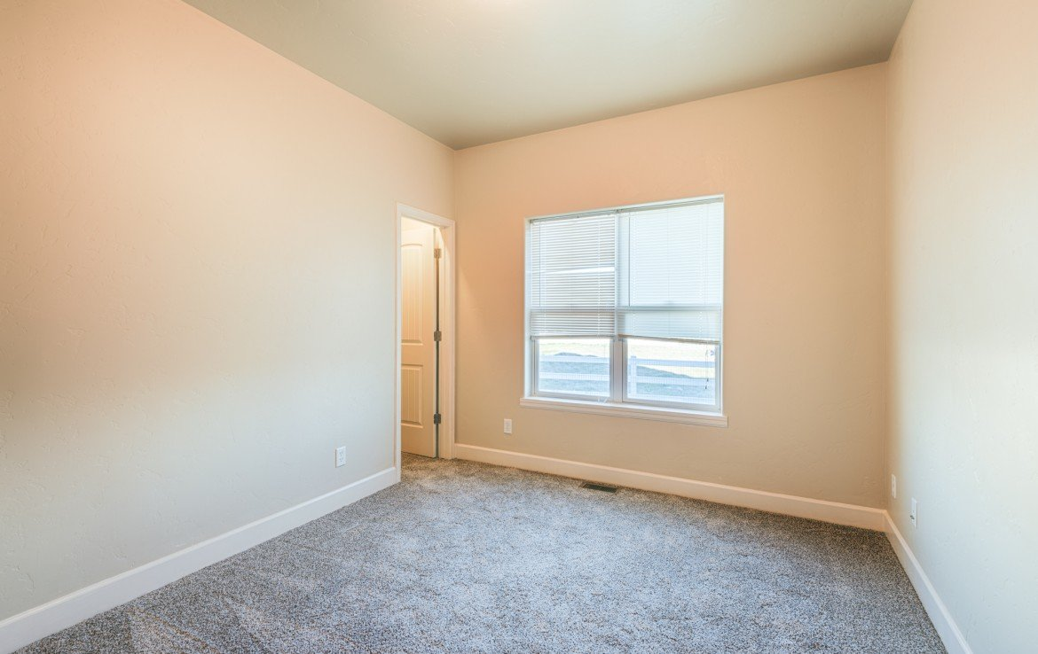 Bedroom with Closet and New Carpeting - 1828 Senate St Montrose, CO 81401 - Atha Team Real Estate