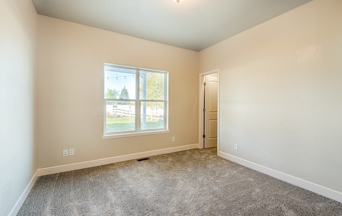 3rd Bedroom with New Carpet - 1828 Senate St Montrose, CO 81401 - Atha Team Real Estate