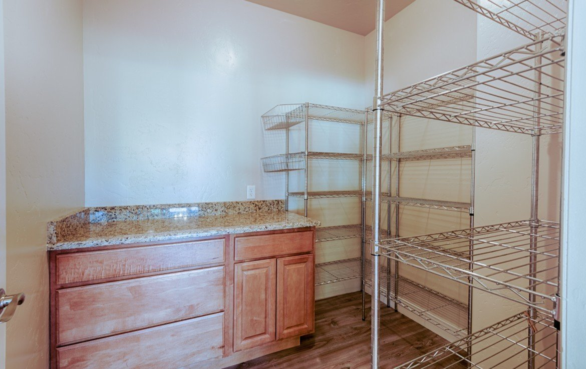 Laundry Room with Cabinet - 1828 Senate St Montrose, CO 81401 - Atha Team Real Estate
