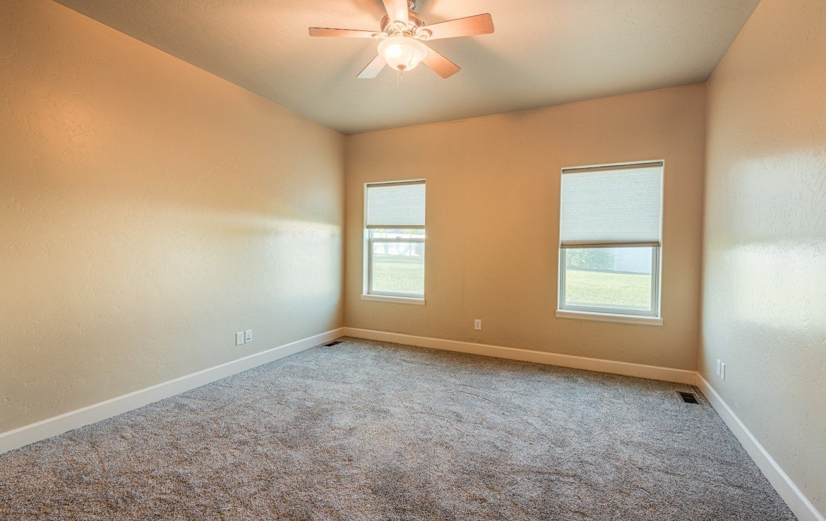 Bedroom with Ceiling Fan - 1828 Senate St Montrose, CO 81401 - Atha Team Real Estate