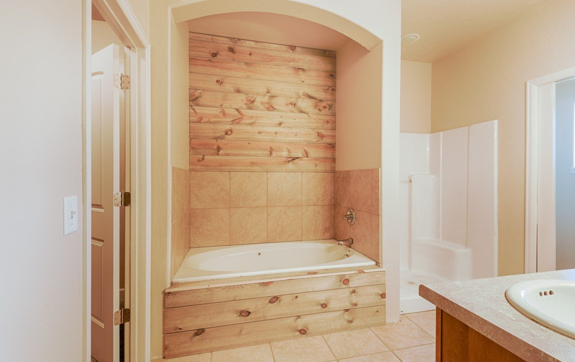 Master Bathroom with Tiled Jetted Tub and Separate Shower - 1828 Senate St Montrose, CO 81401 - Atha Team Real Estate
