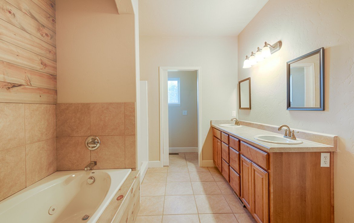 Master Bathroom with Dual Vanity Sinks - 1828 Senate St Montrose, CO 81401 - Atha Team Real Estate