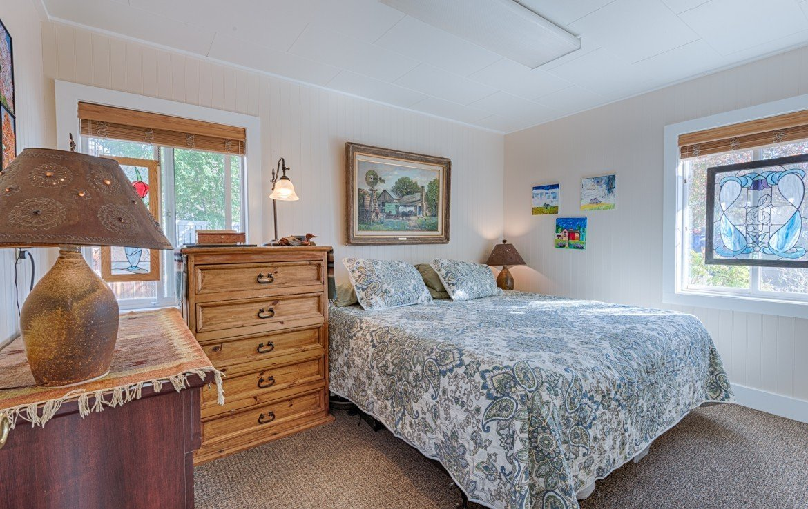 Bedroom with windows and carpet - 21 N Junction Ave Montrose, CO 81401