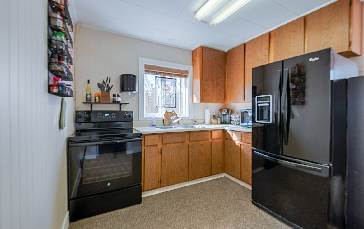 Kitchen Cabinets and Refrigerator- 21 N Junction Ave Montrose, CO 81401