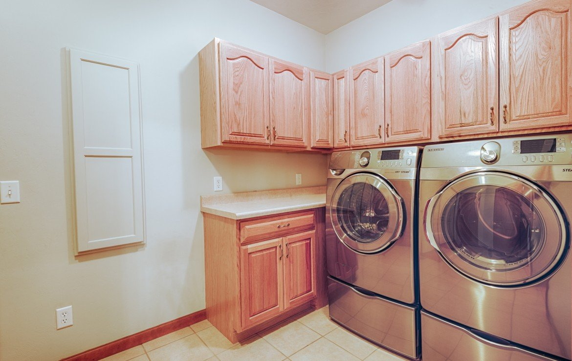Laundry Room with Cabinets - 555 Collins Way Montrose, CO. 81403 - Atha Team at Keller Williams