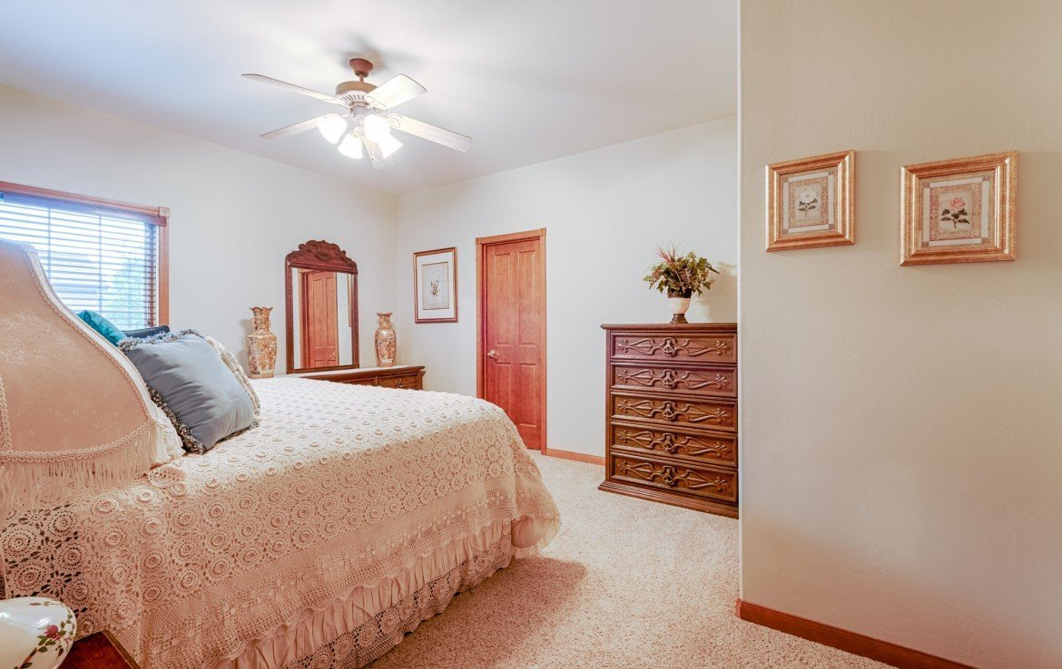 Bedroom with Ceiling Fan - 555 Collins Way Montrose, CO. 81403 - Atha Team at Keller Williams