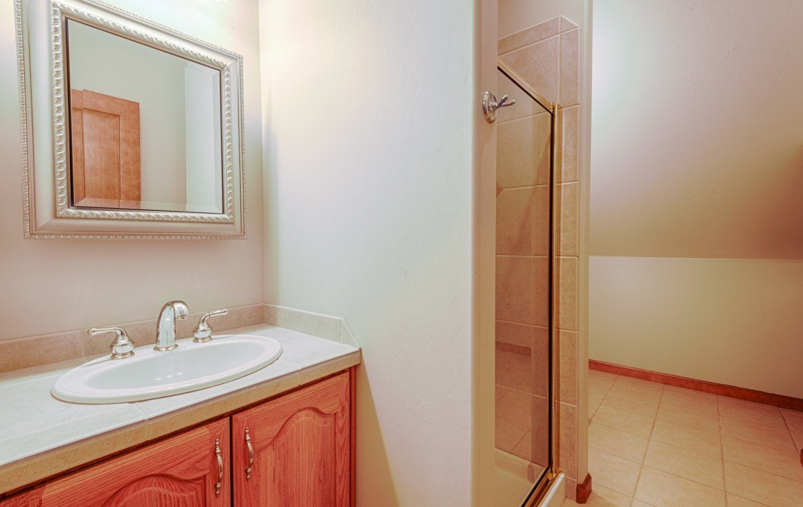 Upstairs 3/4 Bathroom - 555 Collins Way Montrose, CO. 81403 - Atha Team at Keller Williams