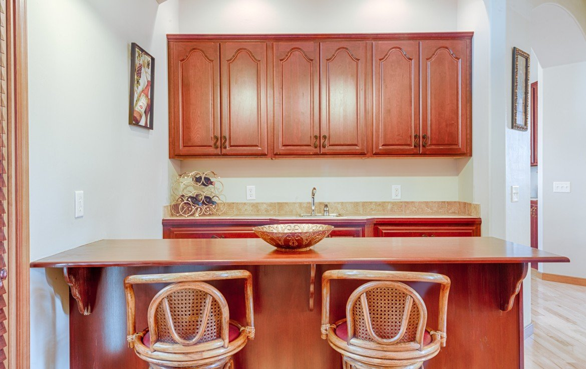 Wet Bar with Bar Stool Seating - 555 Collins Way Montrose, CO. 81403 - Atha Team at Keller Williams