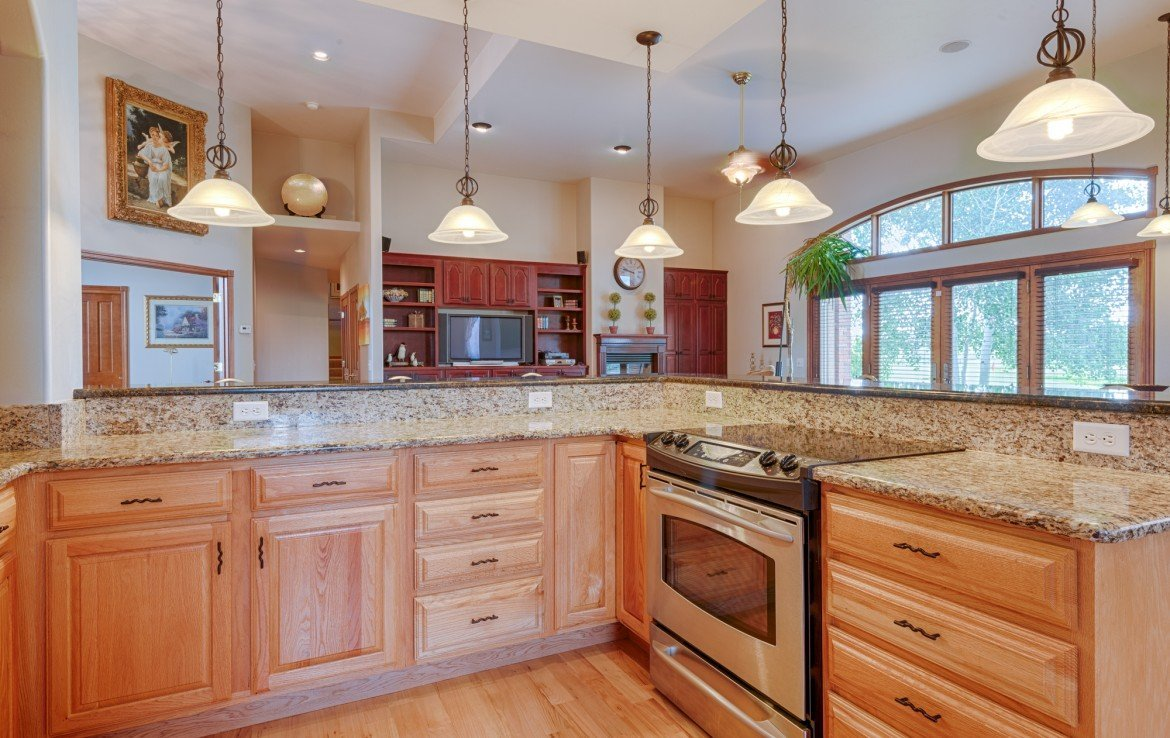 Kitchen with Bar Seating - 555 Collins Way Montrose, CO. 81403 - Atha Team at Keller Williams