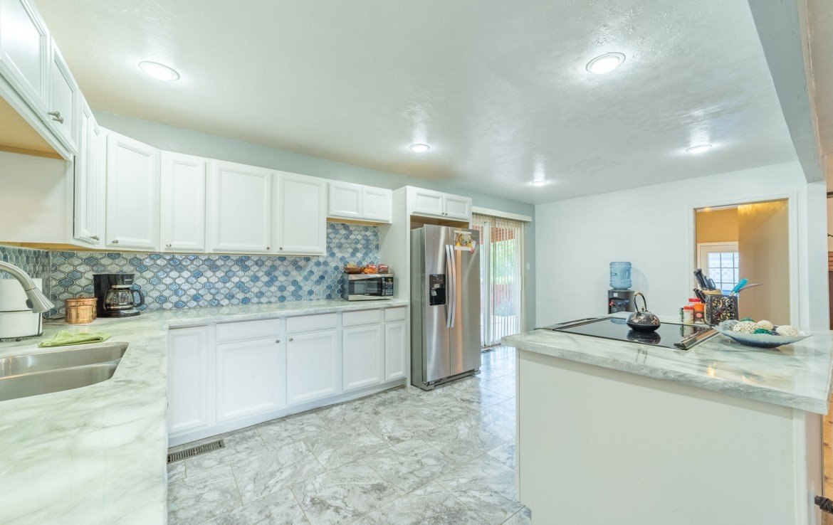 Remodeled Kitchen with Back Yard Sliding Glass Door - 310 Pine View Dr Montrose, CO 81401