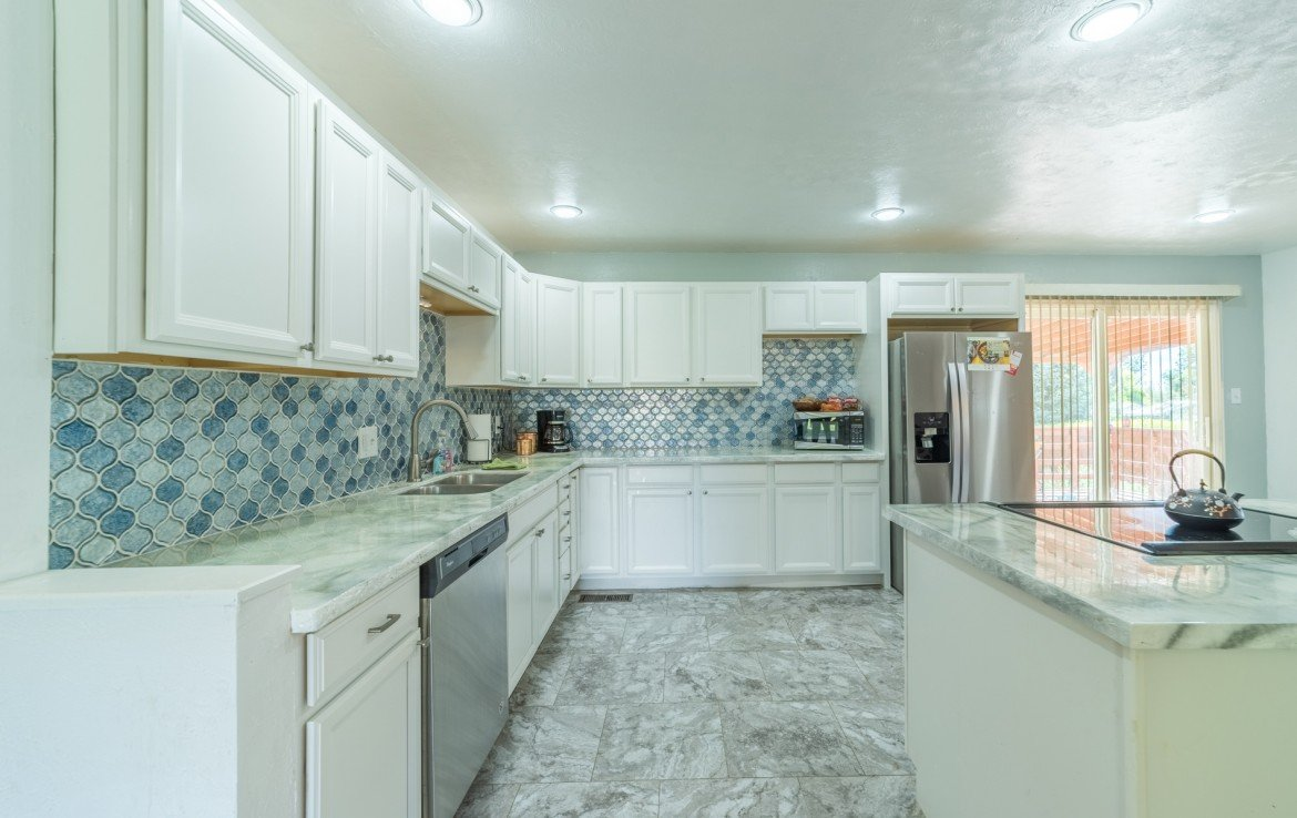 Remodeled Kitchen with New Backsplash - 310 Pine View Dr Montrose, CO 81401