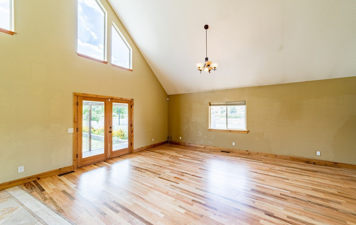 Living Room with Hardwood Flooring - 21561 Government Springs Rd Montrose, CO - Atha Team Realty