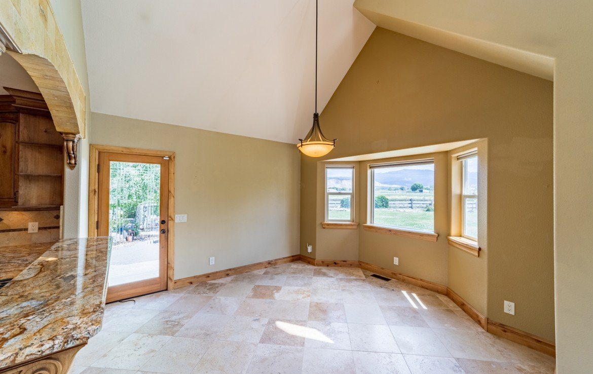Dining Room with Hardwood Flooring - 21561 Government Springs Rd Montrose, CO - Atha Team Realty