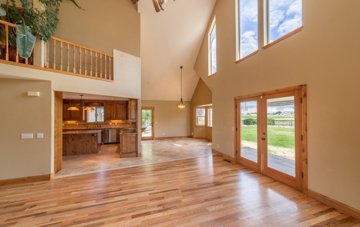 Living Room with Open Concept Floor Plan - 21561 Government Springs Rd Montrose, CO - Atha Team Realty