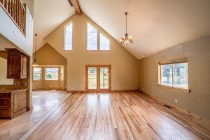 Living Room with Open Beam - 21561 Government Springs Rd Montrose, CO - Atha Team Realty