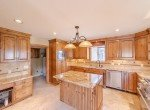 Kitchen with Travertine Tile - 21561 Government Springs Rd Montrose, CO - Atha Team Realty