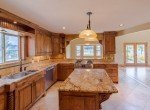 Kitchen with Granite Counters and Center Island - 21561 Government Springs Rd Montrose, CO - Atha Team Realty