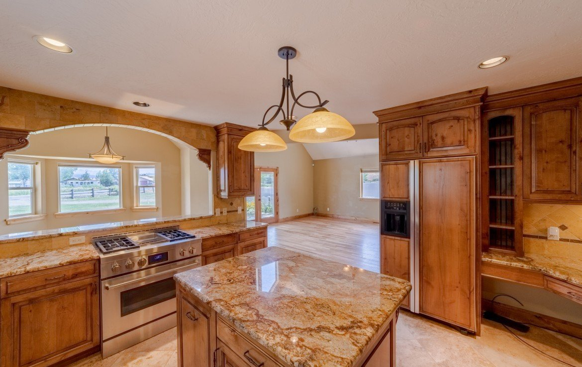 Kitchen with Knotty Elder Cabinets - 21561 Government Springs Rd Montrose, CO - Atha Team Realty
