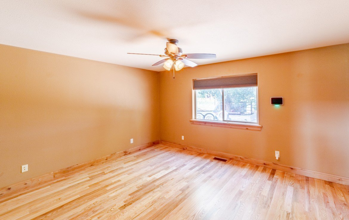 Master Bedroom with Hardwood Floors - 21561 Government Springs Rd Montrose, CO - Atha Team Realty