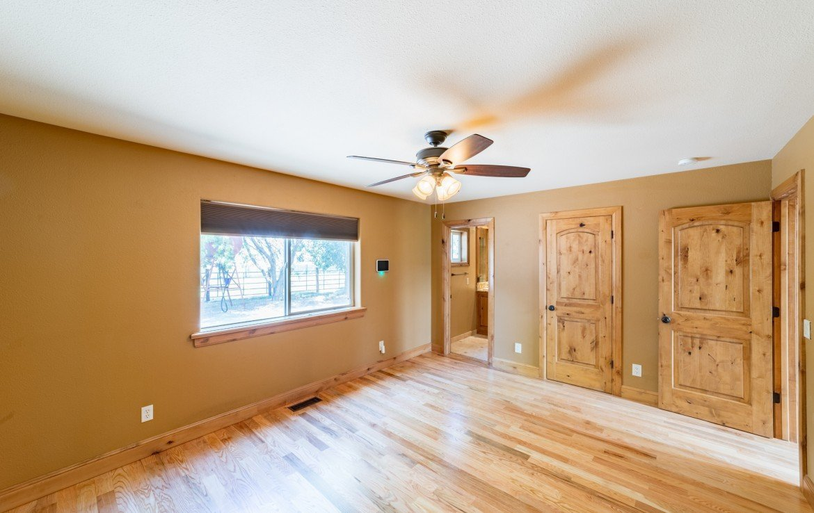 Master Bedroom with Knotty Elder Closet Doors - 21561 Government Springs Rd Montrose, CO - Atha Team Realty