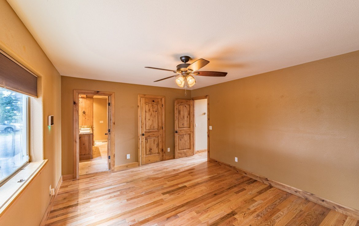 Master Bedroom with Custom Master Bath - 21561 Government Springs Rd Montrose, CO - Atha Team Realty