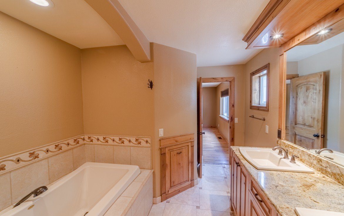 Master Bath with Knotty Elder Cabinets - 21561 Government Springs Rd Montrose, CO - Atha Team Realty