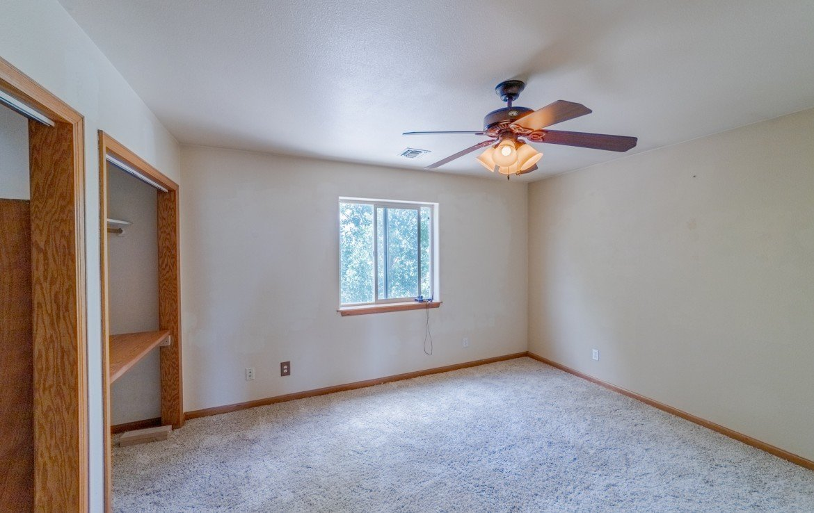 Upstairs Bedroom with Ceiling Fan - 21561 Government Springs Rd Montrose, CO - Atha Team Realty