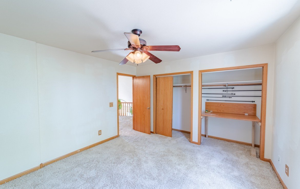 Upstairs Bedroom with Double Closets - 21561 Government Springs Rd Montrose, CO - Atha Team Realty