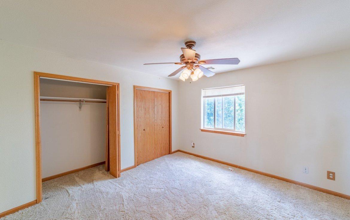 Upstairs Bedroom with Extra Closet - 21561 Government Springs Rd Montrose, CO - Atha Team Realty