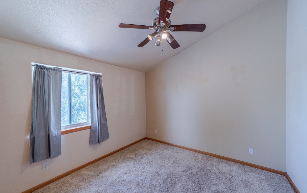 Upstairs Bedroom with Carpet - 21561 Government Springs Rd Montrose, CO - Atha Team Realty