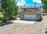 Attached Garage with Gravel Driveway - 21561 Government Springs Rd Montrose, CO - Atha Team Realty