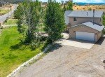 Aerial View of Attached Garage with Gravel Driveway - 21561 Government Springs Rd Montrose, CO - Atha Team Realty