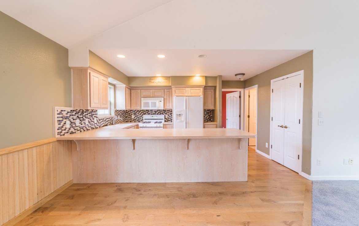 Kitchen with Bar Seating - 2051 Cherry St Montrose, CO - Atha Team Real Estate Agents