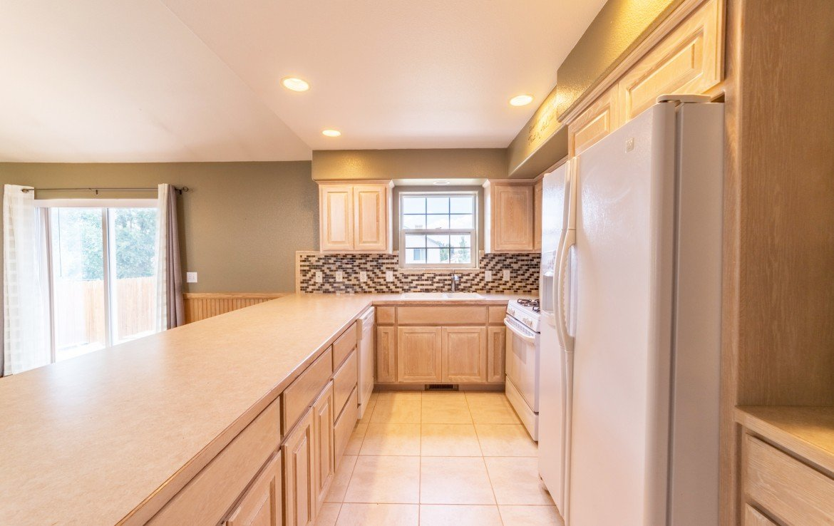 Kitchen with Tile Flooring - 2051 Cherry St Montrose, CO - Atha Team Real Estate Agents