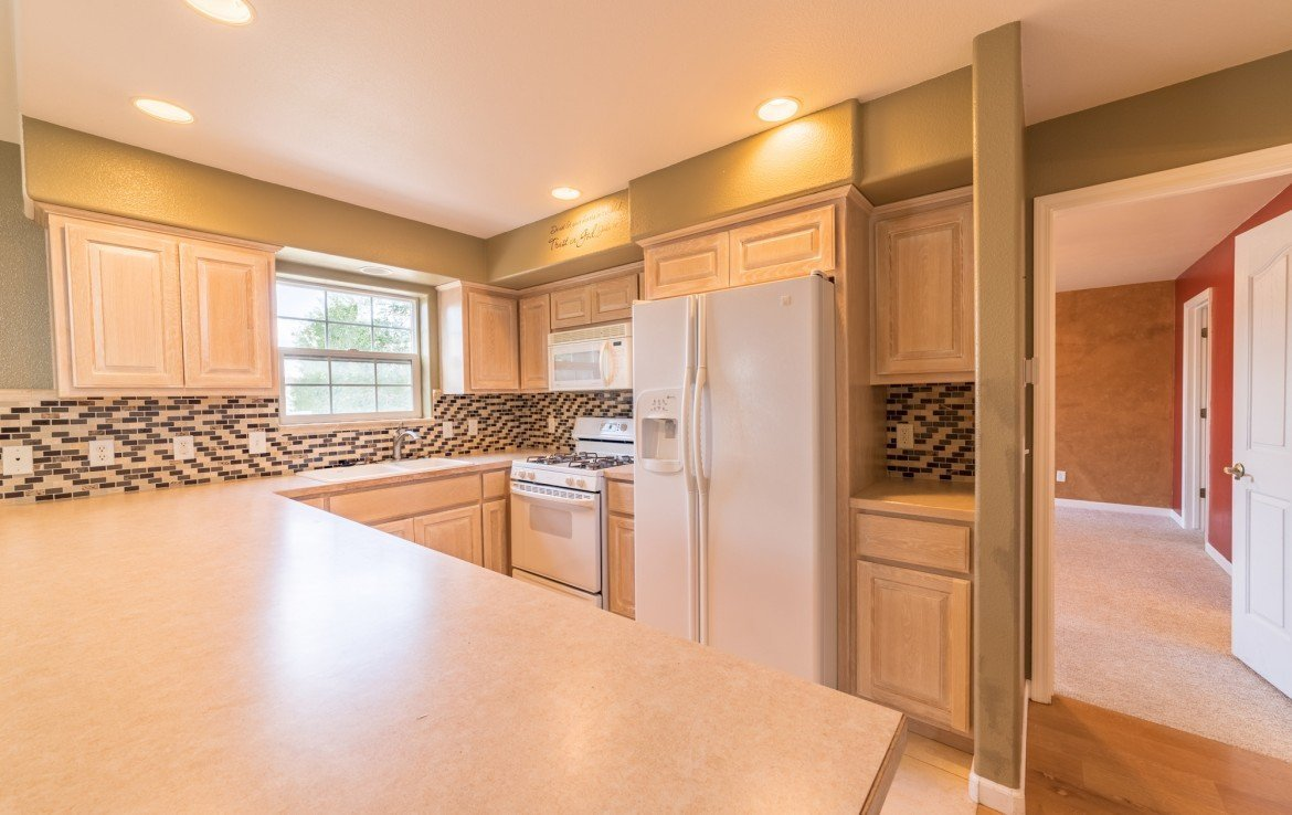 Kitchen with Appliances Included - 2051 Cherry St Montrose, CO - Atha Team Real Estate Agents