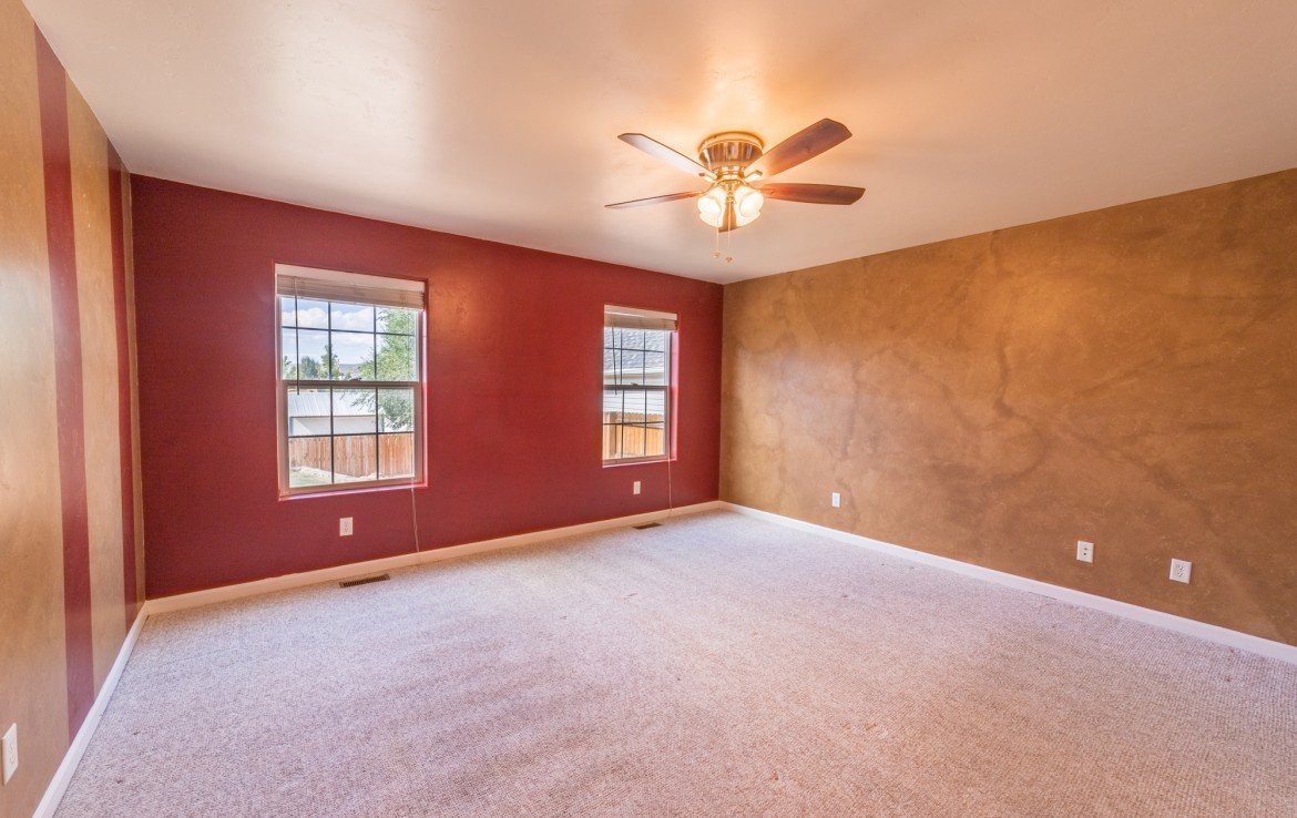 Master Bedroom with Carpeting - 2051 Cherry St Montrose, CO - Atha Team Real Estate Agents