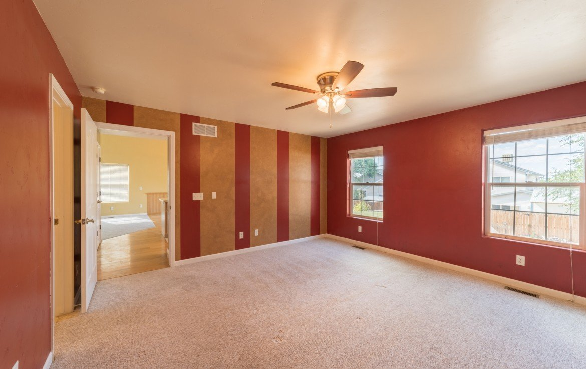 Master Bedroom with Custom Paint - 2051 Cherry St Montrose, CO - Atha Team Real Estate Agents