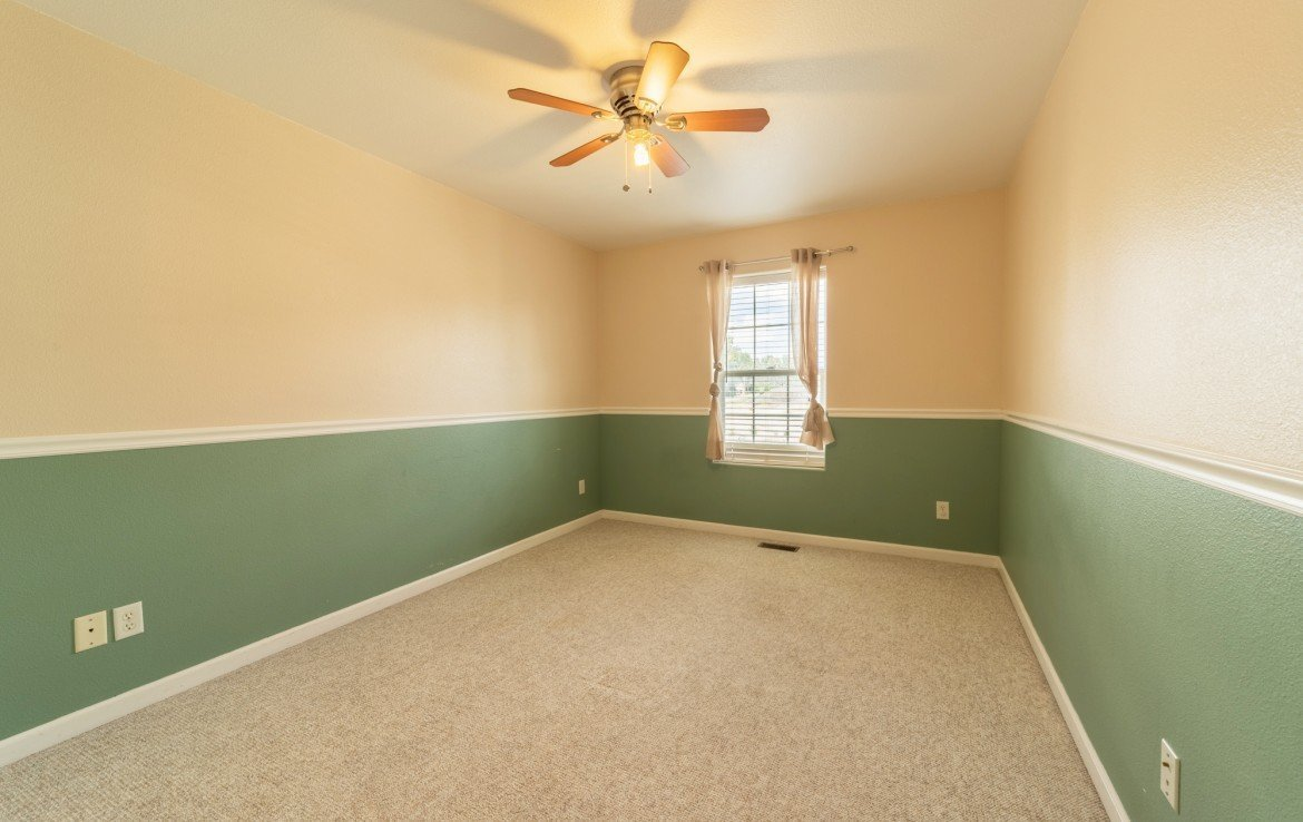 Upstairs Bedroom with Ceiling Fan - 2051 Cherry St Montrose, CO - Atha Team Real Estate Agents