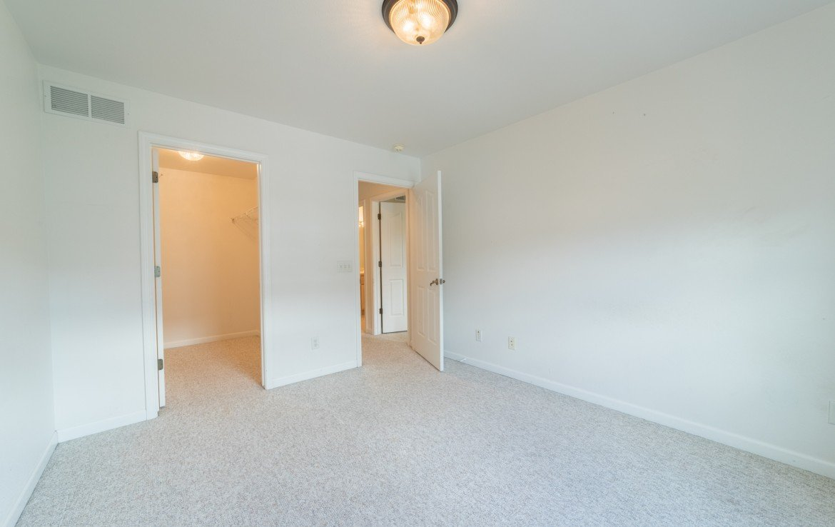 Upstairs Bedroom with Closet - 2051 Cherry St Montrose, CO - Atha Team Real Estate Agents