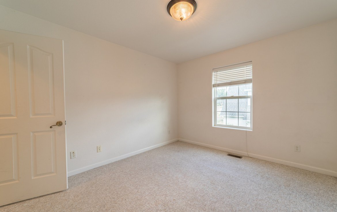 Upstairs Bedroom with Window - 2051 Cherry St Montrose, CO - Atha Team Real Estate Agents
