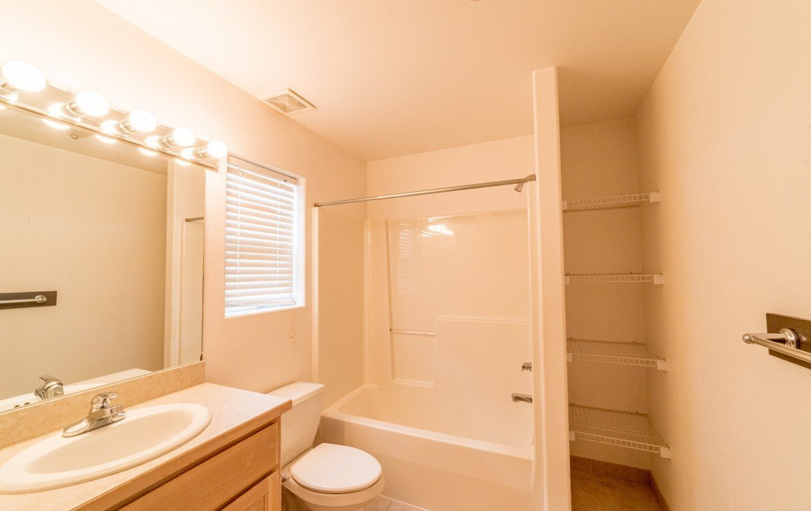 Upstairs Bathroom with Shelving - 2051 Cherry St Montrose, CO - Atha Team Real Estate Agents