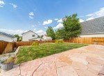 Back Yard with Flagstone Patio - 2051 Cherry St Montrose, CO - Atha Team Real Estate Agents