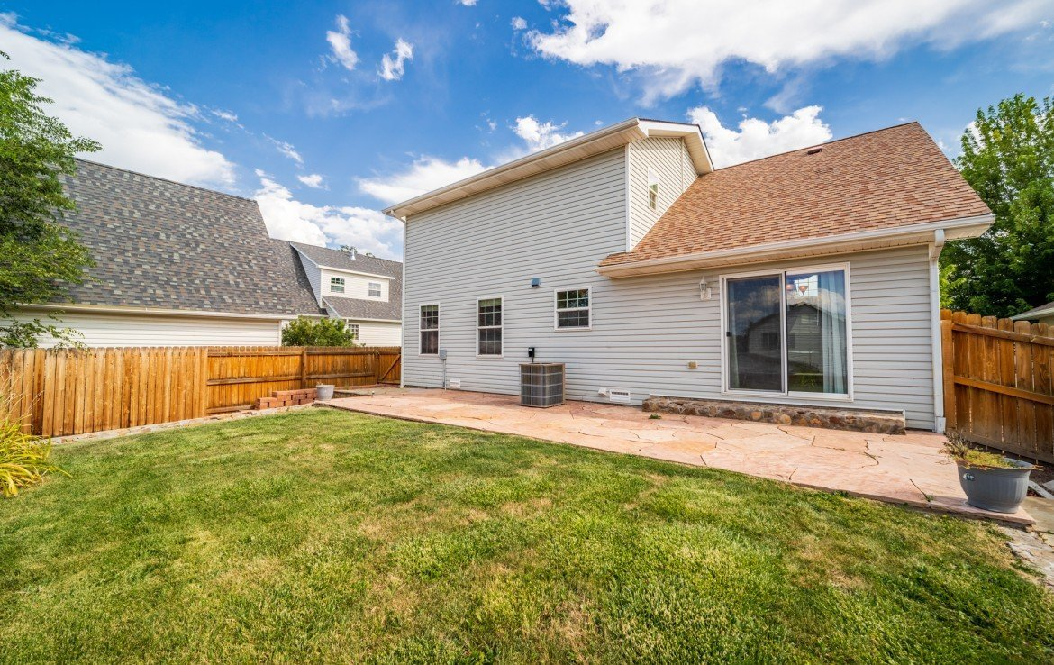 Back Yard with Hot Tub 220V Hookup - 2051 Cherry St Montrose, CO - Atha Team Real Estate Agents