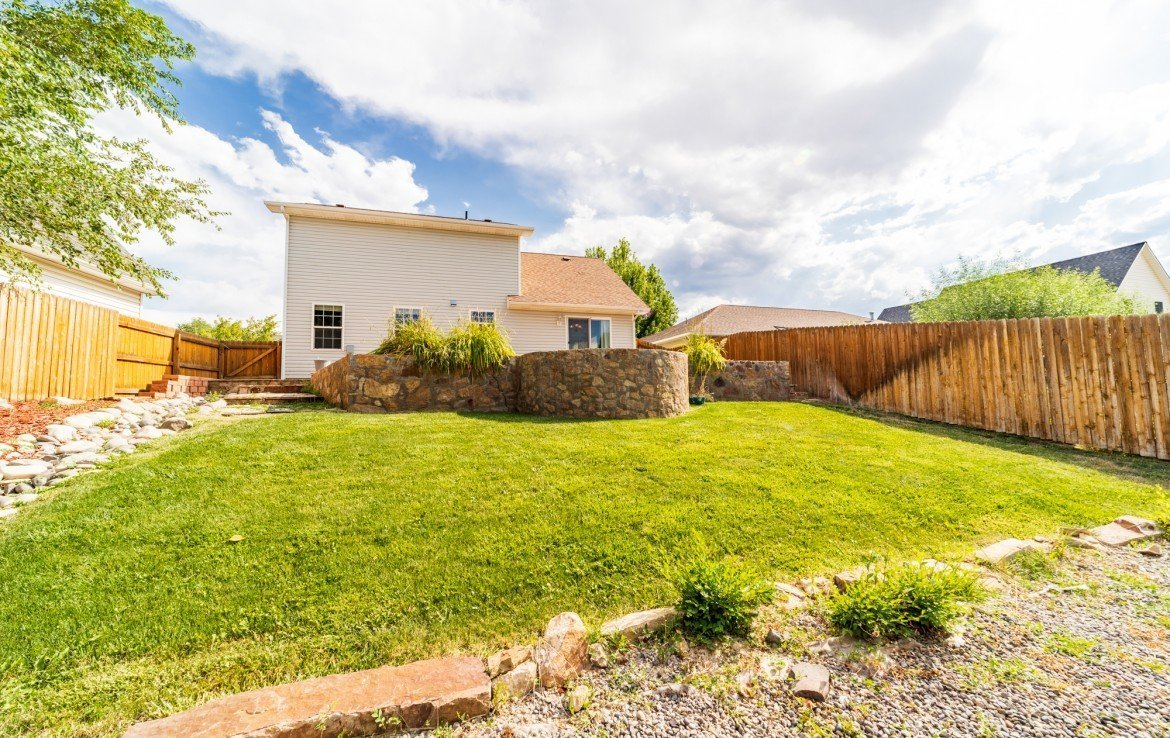 Back Yard with Sprinkler System - 2051 Cherry St Montrose, CO - Atha Team Real Estate Agents