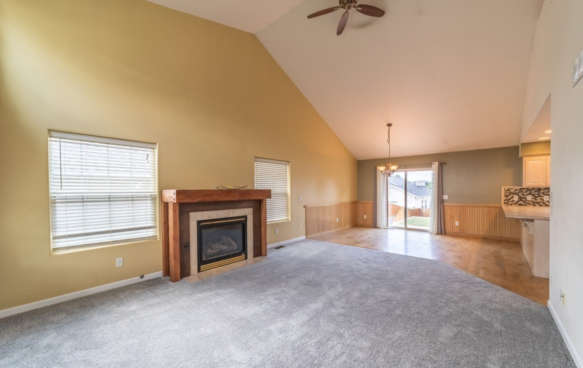 Living Room with Vaulted Ceiling - 2051 Cherry St Montrose, CO - Atha Team Real Estate Agents